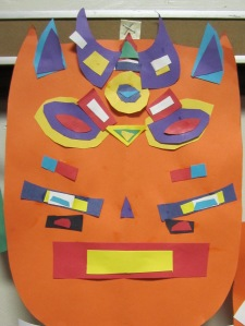 1st grade symmetrical masks inspired by Tribal African Masks- cut paper