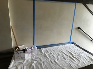 The 5'x5' area taped off and taped with paint and supplies in the box.